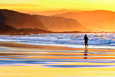 Person Running On Beach At Sunset Print by Mikel Martinez de Osaba