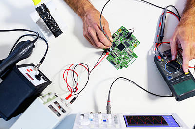 Circuit Photograph - Person Working In An Electronics Lab by Wladimir Bulgar