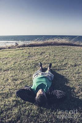 Relaxing Man Laying Down On Tasmanian Coast Field Print by Jorgo Photography - Wall Art Gallery