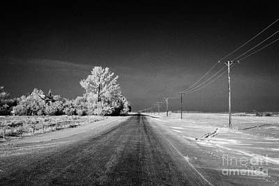 salt and grit covered rural small road in Forget Saskatchewan Canada Print by Joe Fox