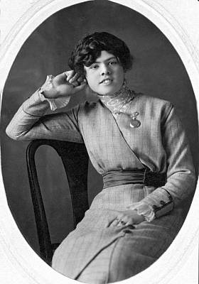 Looking Away From Camera Photograph - Seated Portrait Of Young Woman by Underwood Archives