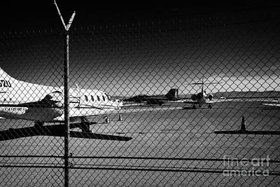 Security Chain Link Fencing With Warning Restricted Area Sign On The Perimeter Of Mccarran Airport Print by Joe Fox