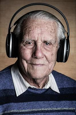Senior Man Wearing Headphones Print by Mauro Fermariello