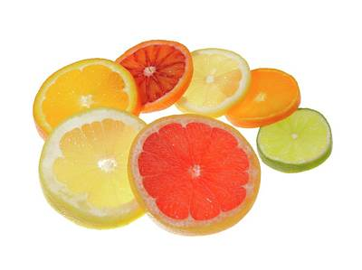 Grapefruit Photograph - Slices Of Citrus Fruit by Cordelia Molloy
