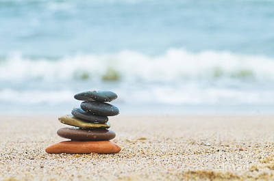 Still Photograph - Stack Of Beach Stones On Sand by Michal Bednarek