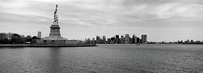 Ellis Island Photograph - Statue Of Liberty With Manhattan by Panoramic Images
