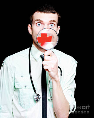 Surprised Doctor Showing Health Care Cross Print by Jorgo Photography - Wall Art Gallery