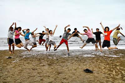Suradej Photograph - Tagteam Jump by Suradej Chuephanich