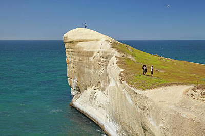 Tourists On Cliff Top At Tunnel Beach Print by David Wall