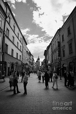 Polish City Photograph - Tourists On The Ulica Florianska Street Leading Down From City Gates To Old Town City Centre Krakow by Joe Fox