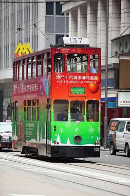 Trams On The Street In Hong Kong Print by Ashley Cooper