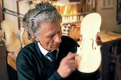 Violin-maker At Work Print by Patrick Landmann