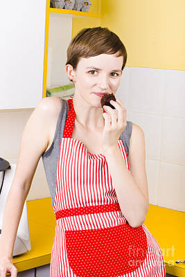 Woman In Apron Eating Cake Print by Jorgo Photography - Wall Art Gallery