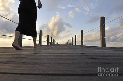 Woman Walking On Wooden Jetty At Sunrise Print by Sami Sarkis