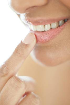 Woman With Her Finger On Her Lip Print by Ian Hooton