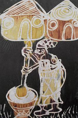 Village Scene.woman Pound The Yam Tuber  Print by Okunade Olubayo