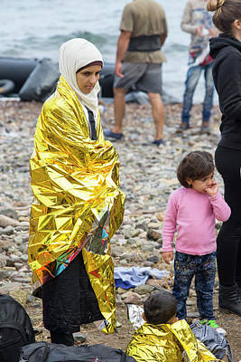 Woman Head Photograph - Syrian Refugees Arriving On Greek Island by Ashley Cooper
