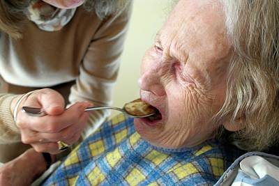 Alzheimers Photograph - Alzheimer's Patient Being Fed by Tony Craddock