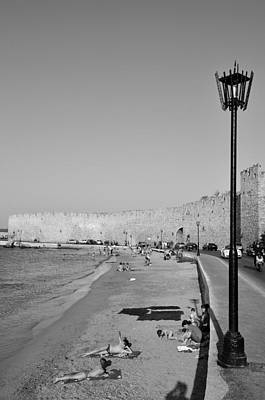 Black And White Photograph - Beach In Front Of The Old City Of Rhodes by George Atsametakis