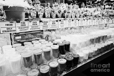Boqueria Photograph - fresh fruit juices for sale inside the la boqueria market in Barcelona Catalonia Spain by Joe Fox