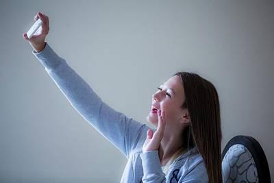 Selfie Photograph - Girl Taking Selfie On Smartphone by Samuel Ashfield