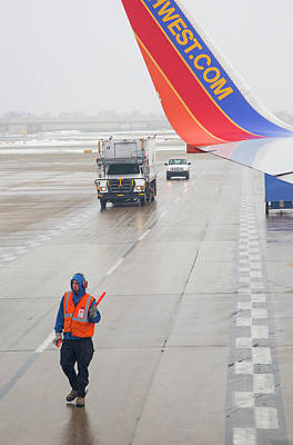 Airlines Photograph - Ground Crew Worker At Chicago Airport by Jim West