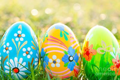 Festive Photograph - Handmade Easter Eggs On Grass by Michal Bednarek