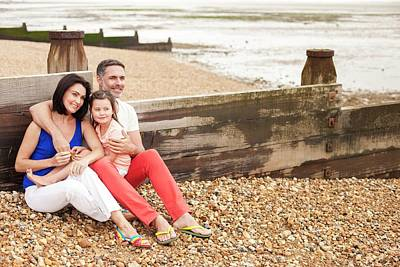 Bonding Photograph - Parents On Beach With Daughter by Ian Hooton