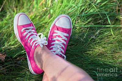 Old-fashioned Photograph - Pink Sneakers On Girl Legs On Grass by Michal Bednarek