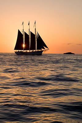 Tall Ship At Sunset Print by Cliff Wassmann