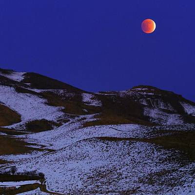 Snowy Night Photograph - Total Lunar Eclipse by Babak Tafreshi