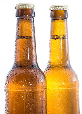Two Wet Bottles Of Beer On White Print by Handmade Pictures