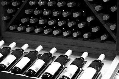 Wine Bottles On A Rack At A Winery Near The Vineyards Print by ELITE IMAGE photography By Chad McDermott