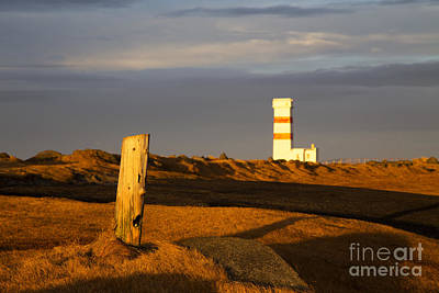 Winter Photograph - Lighthouse by Fabian Roessler