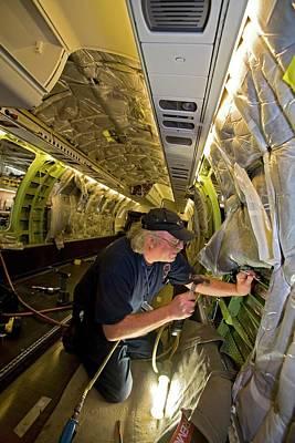 Hangar Photograph - Aircraft Modification by Jim West