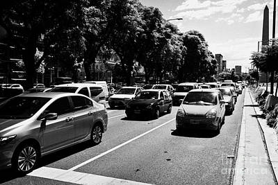 Gridlock Photograph - busy traffic on avenida 9 de julio Buenos Aires Argentina by Joe Fox