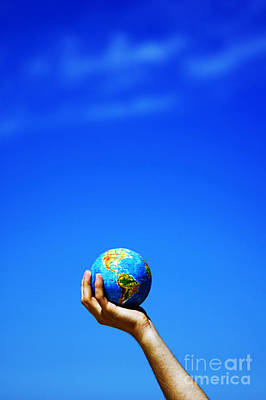 Peaceful Photograph - Earth Globe In Hands. Conceptual Image by Michal Bednarek
