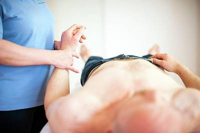 Massaging Photograph - Physiotherapy Session by Dan Dunkley