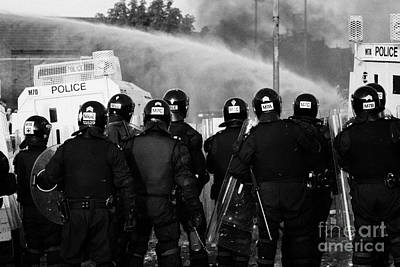 Psni Riot Officers Behind Armoured Land Rover And Water Cannon On Crumlin Road At Ardoyne Shops Belf Print by Joe Fox