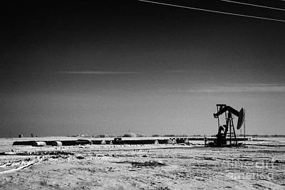 snow covered prairie agricultural farming land with pumpjacks oilfield winter Forget Saskatchewan Ca Print by Joe Fox