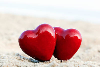 Couple Photograph - Two Red Hearts On The Beach Symbolizing Love by Michal Bednarek