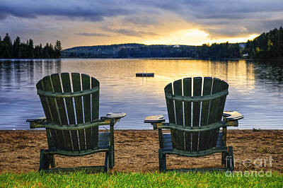 Muskoka Photograph - Wooden Chairs At Sunset On Beach by Elena Elisseeva