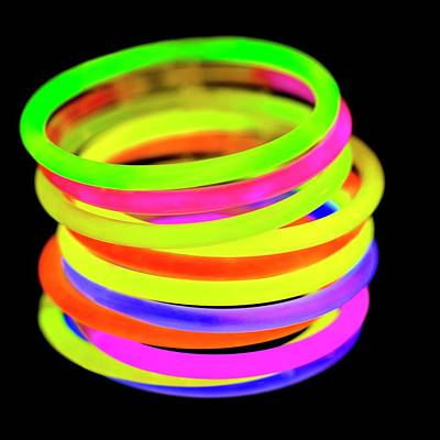 Glow Bracelets Print by Science Photo Library