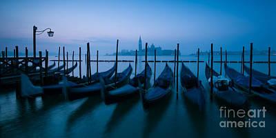 Gondolas Photograph - Row Of Gondolas At Sunrise Venice Italy by Matteo Colombo