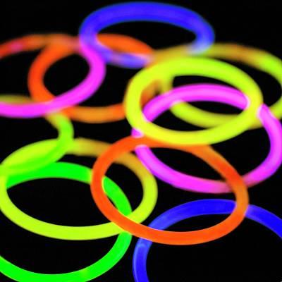 Glow Bracelets Print by Science Photo Library