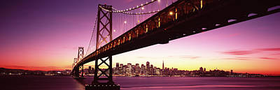 Built Structure Photograph - Bridge Across A Bay With City Skyline by Panoramic Images