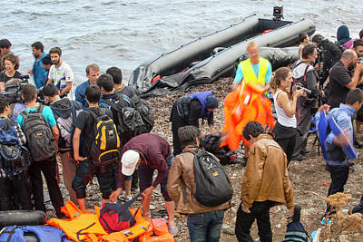 Syrian Refugees Arriving On Greek Island Print by Ashley Cooper