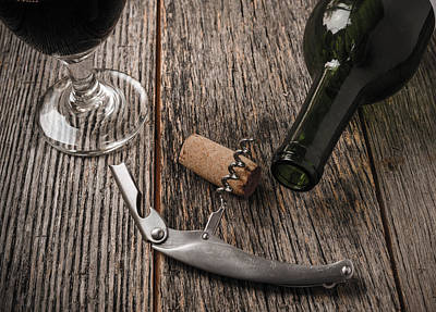 Wine Bottle Photograph - Green Wine Bottle And Cork With Red Wine And Corkscrew by Brandon Bourdages