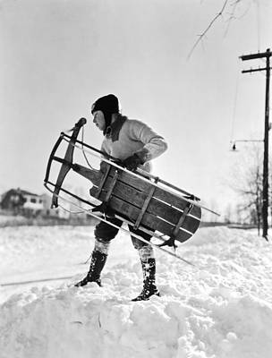 A Boy Carrying His Sled Print by Underwood Archives
