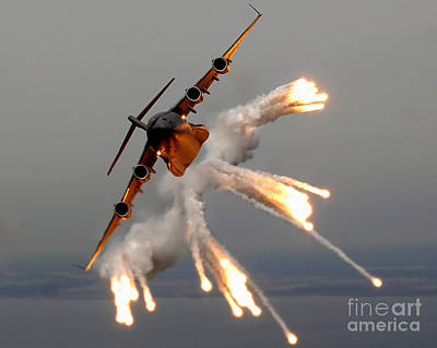 Single Object Photograph - A C-17 Globemaster IIi Releases Flares by Stocktrek Images